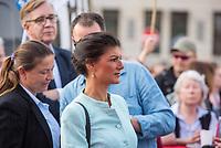 """Kundgebung der Linkspartei am Mittwoch den 18. April 2018 unter dem Motto """"Nein zum Krieg"""" in Berlin vor dem Brandenburger Tor. Mehrere hundert Menschen kamen um Reden von Bundestagsabgeordneten der Partei und Mitgliedern von Friedensinitiativen zu hoeren.<br /> Im Bild: Sarah Wagenknecht, Fraktionsvorsitzende der Partei im Bundestag.<br /> 27.1.2018, Berlin<br /> Copyright: Christian-Ditsch.de<br /> [Inhaltsveraendernde Manipulation des Fotos nur nach ausdruecklicher Genehmigung des Fotografen. Vereinbarungen ueber Abtretung von Persoenlichkeitsrechten/Model Release der abgebildeten Person/Personen liegen nicht vor. NO MODEL RELEASE! Nur fuer Redaktionelle Zwecke. Don't publish without copyright Christian-Ditsch.de, Veroeffentlichung nur mit Fotografennennung, sowie gegen Honorar, MwSt. und Beleg. Konto: I N G - D i B a, IBAN DE58500105175400192269, BIC INGDDEFFXXX, Kontakt: post@christian-ditsch.de<br /> Bei der Bearbeitung der Dateiinformationen darf die Urheberkennzeichnung in den EXIF- und  IPTC-Daten nicht entfernt werden, diese sind in digitalen Medien nach §95c UrhG rechtlich geschuetzt. Der Urhebervermerk wird gemaess §13 UrhG verlangt.]"""