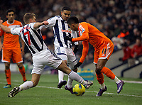 Pictured: Scott Sinclair of Swansea (R) challenged by James Morrison (L) of West Bromwich. Saturday, 04 February 2012<br /> Re: Premier League football, West Bromwich Albion v Swansea City FC v at the Hawthorns Stadium, Birmingham, West Midlands.
