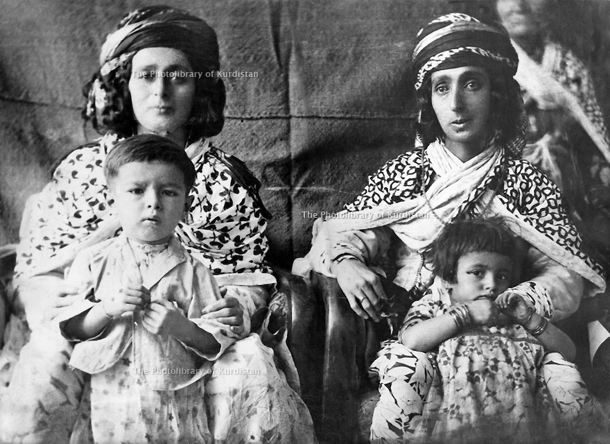 Iraq 1939.Left,Aicha Khan, wife of Sheikh Mahmoud Barzinji, in Suleimania with her grand-child Baba  Tahir Sheikh Jalal and right, Hafsa Khan with?  .Irak 1939  .A gauche,Aicha Khan, femme de Sheikh Mahmoud et son petit-fils, a droite Hafsa  Khan avec ?