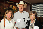 From left: Karen, David and Sue Isham at a invitation-only reception and book-signing for Phil Collins at Torch Energy Advisors Wednesday May 9,2012. (Dave Rossman Photo)