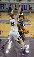 Bentonville West's Jacob McGhee (right) drives to the lane Tuesday, Jan. 5, 2021, as he is guarded by Fayetteville's Will Yoakley (21) during the first half of play in Bulldog Arena in Fayetteville. Visit nwaonline.com/210106Daily/ for today's photo gallery. <br /> (NWA Democrat-Gazette/Andy Shupe)