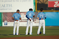 (L-R) Kevon Jackson (11), Diego Hernandez (4), and Mikey Filia (29) of the Burlington Royals stand for the National Anthem prior to the game against the Johnson City Cardinals at Burlington Athletic Stadium on September 3, 2019 in Burlington, North Carolina. The Cardinals defeated the Royals 7-2 to even Appalachian League Championship series at one game a piece. (Brian Westerholt/Four Seam Images)