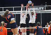 Auburn Senior Val Green (16) spike ball against Gracie Ryan (21) and Abigail Archibong (9) of Arkansas on Sunday, Oct. 10, 2021, during play at Barnhill Arena, Fayetteville. Visit nwaonline.com/211011Daily/ for today's photo gallery.<br /> (Special to the NWA Democrat-Gazette/David Beach)