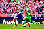 Rodrigo Cascante of Atletico de Madrid (L) fights for the ball with Joaquin Rodriguez of Real Betis (R) during the La Liga 2018-19 match between Atletico de Madrid and Real Betis at Wanda Metropolitano Stadium on October 07 2018 in Madrid, Spain. Photo by Diego Souto / Power Sport Images