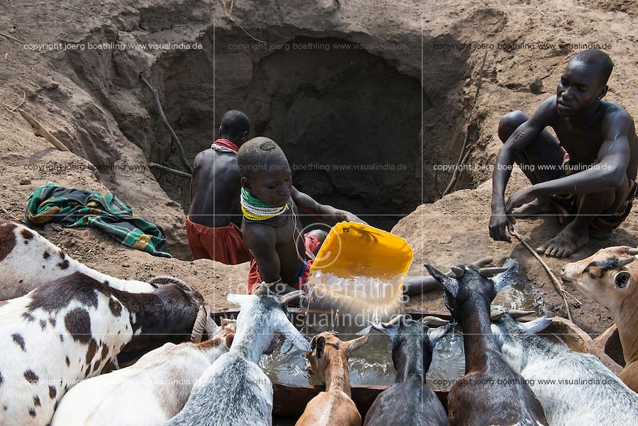ETHIOPIA, Southern Nations, Lower Omo valley, Kangaten, village Kakuta, Nyangatom tribe, shepherds give water to their goats from water holes at dry river Kibish / AETHIOPIEN, Omo Tal, Kangaten, Dorf Kakuta, Nyangatom Hirtenvolk, Hirten traenken das Vieh aus Wasserloechern am trocknen Fluss Kibish