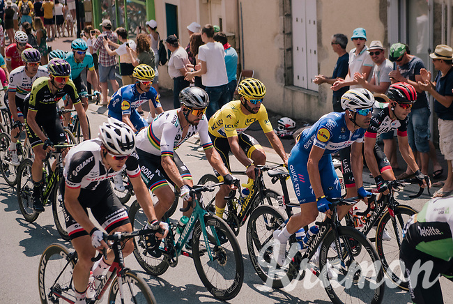 World Champion Peter Sagan (SVK/Bora-Hansgrohe) & yellow jersey / GC leader Fernando Gaviria (COL/Quick-Step Floors) together in the peloton, rolling through the town of  Réaumur<br /> <br /> Stage 2: Mouilleron-Saint-Germain > La Roche-sur-Yon (183km)<br /> <br /> Le Grand Départ 2018<br /> 105th Tour de France 2018<br /> ©kramon