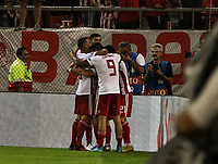 Olympiakos players celebrate the 4th goal from Daniel Podence during the UEFA Champions League playoff first leg soccer match between Olympiakos and Krasnodar at Karaiskaki stadium in Piraeus, Greece, on 21 August 2019