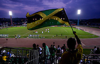 Jamaican flag fan. The United States played Jamaica during the CONCACAF Men's Under 17 Championship at Catherine Hall Stadium in Montego Bay, Jamaica.