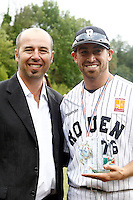 17 July 2011: Jordan Crystal of the Rouen Huskies poses with Didier Seminet, president of the French Federation of Baseball after the 2011Challenge de France final match won 6-4 by the Rouen Huskies over the Savigny Lions, at Stade Pierre Rolland, in Rouen, France.