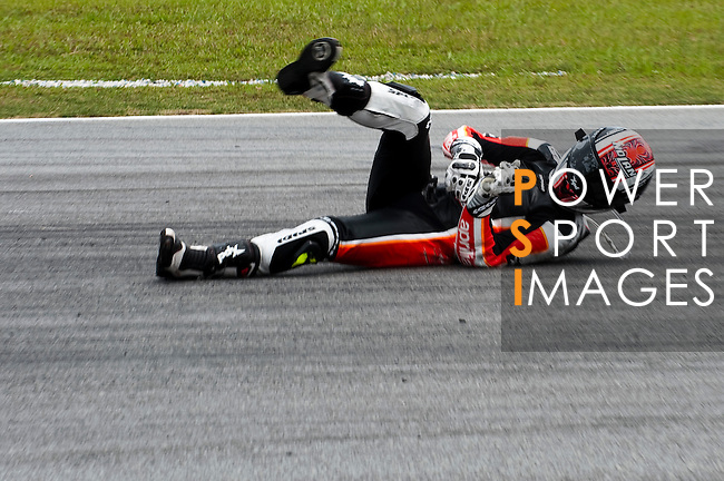 KUALA LUMPUR, MALAYSIA - OCTOBER 25: Padock GP Racing Team rider Mattia Pasini of Italy crashes out during the 250cc race on the Malaysian MotoGP, which is round 16 of the MotoGP World Championship at the Sepang Circuit on October 25, 2009 in Kuala Lumpur, Malaysia. Photo by Victor Fraile / The Power of Sport Images