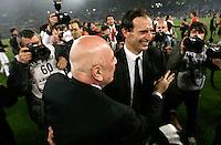 Calcio, Serie A: Roma-Milan. Roma, stadio Olimpico, 7 maggio 2011..Football, Italian serie A: AS Roma vs AC Milan. Rome, Olympic stadium, 7 may 2011..AC Milan managing director Adriano Galliani embraces coach Massimiliano Allegri, right, at the end of the match, to celebrate the winning of the 18th championship..UPDATE IMAGES PRESS/Riccardo De Luca