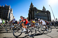 Picture by Alex Whitehead/SWpix.com - 07/09/2014 - Cycling - 2014 Friends Life Tour of Britain - Stage 1, Liverpool - BMC Racing Team's Rick Zabel and the peloton ride past the Royal Liver Building during Stage 1 of the Tour of Britain in Liverpool.