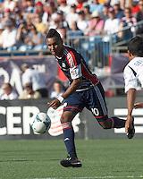 New England Revolution midfielder Juan Agudelo (10) on the attack.  In a Major League Soccer (MLS) match, the New England Revolution (blue) defeated LA Galaxy (white), 5-0, at Gillette Stadium on June 2, 2013.