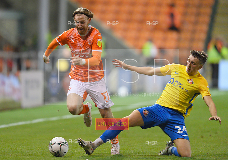 24/08/2021 Carabao Cup 2nd Round Blackpool v Sunderland <br /> <br /> Josh Bowler  avoids a challenge by Dan Neil