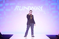 23 year-old Saskatoon, SK native Evan Biddell was named the first-ever winner of Slice's Project Runway Canada.(CNW Group/Alliance Atlantis Commmunications Inc.)
