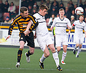 Raith Rovers' Dougie Hill holds off Alloa's Andrew Kirk.