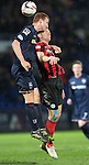 Ross County v St Johnstone....07.04.15   SPFL<br /> Scott Boyd gets above Steven MacLean<br /> Picture by Graeme Hart.<br /> Copyright Perthshire Picture Agency<br /> Tel: 01738 623350  Mobile: 07990 594431