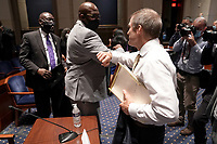 Philonise Floyd, brother of George Floyd, elbow bumps United States Representative Jim Jordan (Republican of Ohio) after a US House Judiciary Committee hearing to discuss police brutality and racial profiling on Wednesday, June 10, 2020.<br /> Credit: Greg Nash / Pool via CNP/AdMedia
