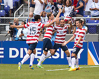 Clarence Goodson (21) of the United States celebrates his goal with teammate Landon Donovan (10) during the quarterfinals of the CONCACAF Gold Cup at M&T Bank Stadium in Baltimore, MD.  The United States defeated El Salvador, 5-1.