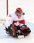 Sochi, RUSSIA - Mar 11 2014 -  Corbin Watson makes a save with his helmet as Canada takes on Czech Republic in Sledge Hockey at the 2014 Paralympic Winter Games in Sochi, Russia.  (Photo: Matthew Murnaghan/Canadian Paralympic Committee)