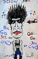A cartoon drawing of Gaddifi on a wall in Benghazi reading 'Go go yes mr crazy'. On 17 February 2011 Libya saw the beginnings of a revolution against the 41 year regime of Col Muammar Gaddafi.