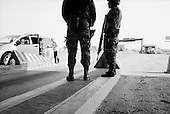 Nuevo Laredo, Mexico<br /> June 7, 2007<br /> <br /> The Mexican military operate a heavily armed check-point just south of Nuevo Laredo, a United States border town know for it's dug trafficking and murder rate. All vehicles are inspected here for illegal drugs as they head north.