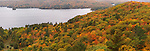 Panoramic aerial fall nature scenery of the Lake of Bays and hills covered with thick carpet of mixed colorful forest. Dorset, Ontario, Canada.