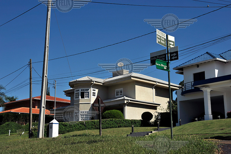 A luxury house inside Ciudad del Este's gated community. Ciudad del Este's economy is based on contraband trade of electronic goods and smuggling along the Triple Frontier, the tri-border area between Paraguay, Brazil and Argentina, where migratory and customs control are practically non-existent.