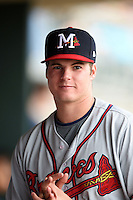 Mississippi Braves pitcher Jason Hursh (8) in the dugout during a game against the Montgomery Biscuits on April 22, 2014 at Riverwalk Stadium in Montgomery, Alabama.  Mississippi defeated Montgomery 6-2.  (Mike Janes/Four Seam Images)
