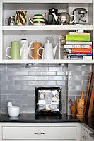Several jugs on the shelf
