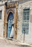 Tunisia, Sidi Bou Said.  Curtain Gently Waves in a House Doorway.