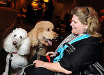 """Linda Nickels with Bear and Nova at the """"Dog Days of Summer"""" Yappy Hour benefitting Citizens for Animal Protection and Golden Beginnings Golden Retriever Rescue at Hotel Derek Wednesday July 21,2010.(Dave Rossman/For the Chronicle)"""