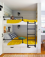 In the boys' bedroom, the bunk beds include shelving, storage, and secret hiding nooks for treasures. The railing and ladder are made of inexpensive gas pipe. Bright yellow bed covers provide a vibrant pop of colour.