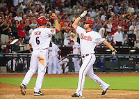 Apr. 30, 2008; Phoenix, AZ, USA; Arizona Diamondbacks pinch hitter Micah Owings (right) is congratulated by Stephen Drew after hitting a sixth inning home run against the Houston Astros at Chase Field. Mandatory Credit: Mark J. Rebilas-