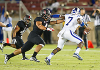 STANFORD, CA - September 8, 2012: Stanford linebacker Blake Martinez (4) applies pressure to the Duke quarterback during the Stanford Cardinal vs the Duke Blue Devils at Stanford Stadium in Sanford, CA. Final score Stanford 50, Duke 13.