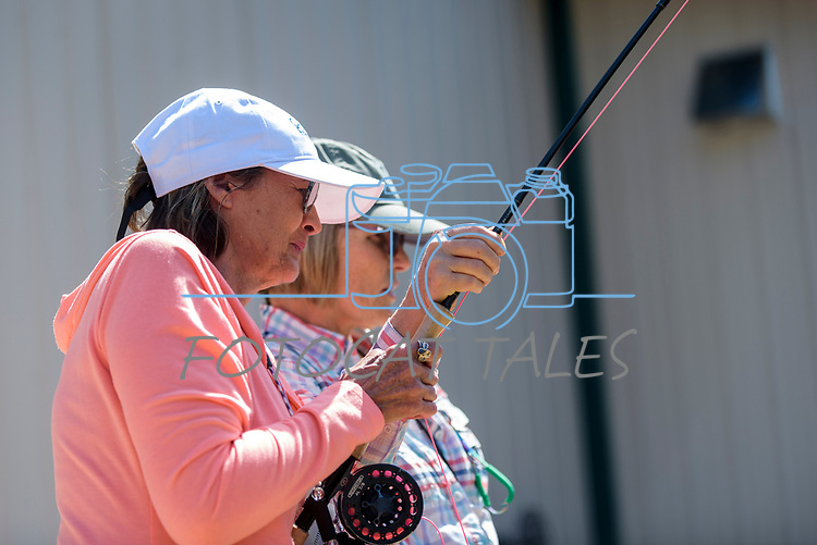 Tammy Callahan learns to fly fish with the help her River Buddy Laura Murph during the Casting for Recovery fishing clinic at Bently Ranch in Gardnerville, Nev. May 4, 2018.<br /> Photo by Candice Vivien/Nevada Momentum