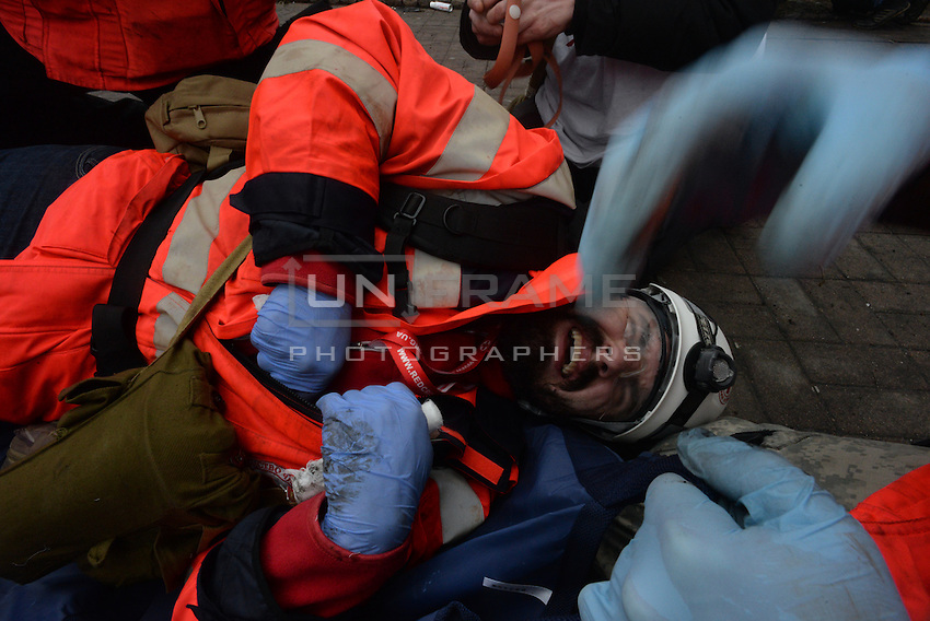 Red Cross Medics have been targeted and hit on the battlefield of maidan square while tryng to help other injured people.  Kiev, Ukraine