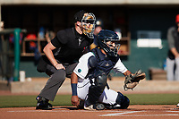 Charleston RiverDogs catcher Michael Bergland (15) sets a target as home plate umpire Matt Blackborow looks on during the game against the Down East Wood Ducks at Joseph P. Riley, Jr. Park on September 26, 2021 in Charleston, South Carolina. (Brian Westerholt/Four Seam Images)