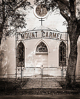 The exterior facade and sign of the Mt. Carmel church.