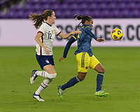 ORLANDO, FL - JANUARY 22: Kena Romero #9 turns away from Tierna Davidson #12 during a game between Colombia and USWNT at Exploria stadium on January 22, 2021 in Orlando, Florida.