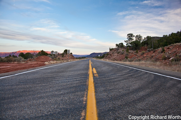 Highway 90 stretches to the horizon along the floor of Paradox Valley, Colorado.