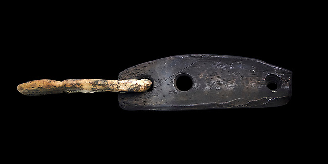 Bone hook & eye fastener thought to be for fastening clothing. Many have been found at Catalhoyuk . Catalhoyuk collection, Konya Archaeological Museum, Turkey. Against a black background