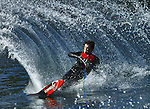 Waterskier throws a wall of water.