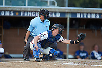 High Point-Thomasville HiToms catcher Jonathan Barham (35) (College of Charleston) sets a target as home plate umpire Brian Pitts looks on during the game against the Martinsville Mustangs at Finch Field on July 26, 2020 in Thomasville, NC.  The HiToms defeated the Mustangs 8-5. (Brian Westerholt/Four Seam Images)
