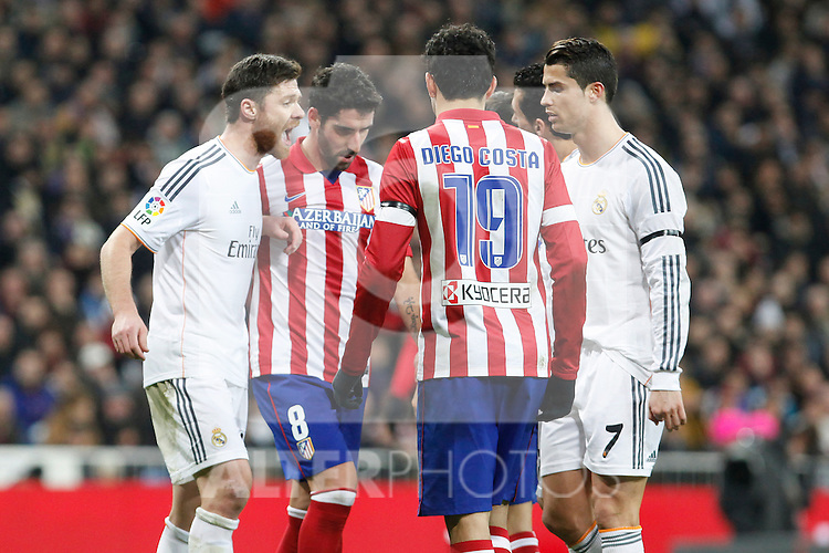 Real Madrid´s Xabi Alonso (L) and Ronaldo (R) and Atletico de Madrid´s Raul Garcia (2L) during King´s Cup (Copa del Rey) semifinal match in Santiago Bernabeu stadium in Madrid, Spain. February 05, 2014. (ALTERPHOTOS/Victor Blanco)