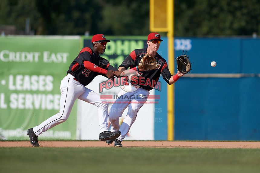 Batavia Muckdogs second baseman Demetrius Sims (55) fields a ground ball in front of first baseman Sean Reynolds (15) during the second game of a doubleheader against the Williamsport Crosscutters on August 20, 2017 at Dwyer Stadium in Batavia, New York.  Batavia defeated Williamsport 4-3.  (Mike Janes/Four Seam Images)