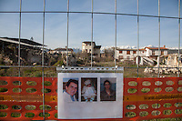 """Onna, a few Kilometres from L'Aquila, is a village that was almost completely erased by the earthquake of April 6, 2009.  85% of its old buildings went destroyed, killing 40. <br /> Thanks to the initiative """"Come era bella Onna"""" (""""How beautiful Onna was"""") a path has been setup. It unfolds through the rubble of the houses that collapsed. On the occasion of the commemoration of the 6th anniversary of the earthquake, relatives of the victims hanged portraits in front of what remains of their respective houses.  Onna, Italy. April 10, 2015"""
