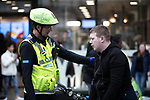 © Joel Goodman - 07973 332324 . 06/04/2017 . Manchester , UK . A paramedic tends to a man , believed to have consumed spice , in Piccadilly Gardens . An epidemic of abuse of the drug spice by some of Manchester's homeless population , in plain sight , is causing users to experience psychosis and a zombie-like state and is daily being witnessed in the Piccadilly Gardens area of Manchester , drawing large resource from paramedic services in the city centre . Photo credit : Joel Goodman