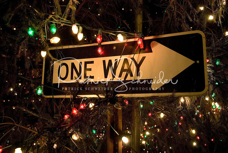 Christmas lights adorn a street sign in McAdenville, NC. The quiet little town of McAdenville, which lies along the South Fork River in Gaston County, N.C., comes alive in spectacular fashion each year as Christmas draws near.  Almost overnight, the small textile town is transformed into Christmas Town, USA.