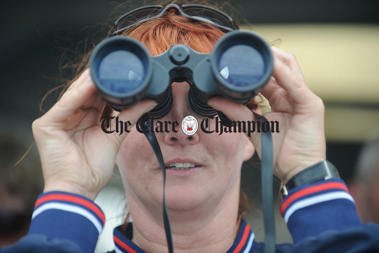 Anne Potter keeps an eye on proceedings at the Leon Currach Regatta at Seafield, Quilty. Photograph by John Kelly.